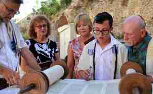 a boy reading the torah at his bar mitzvah