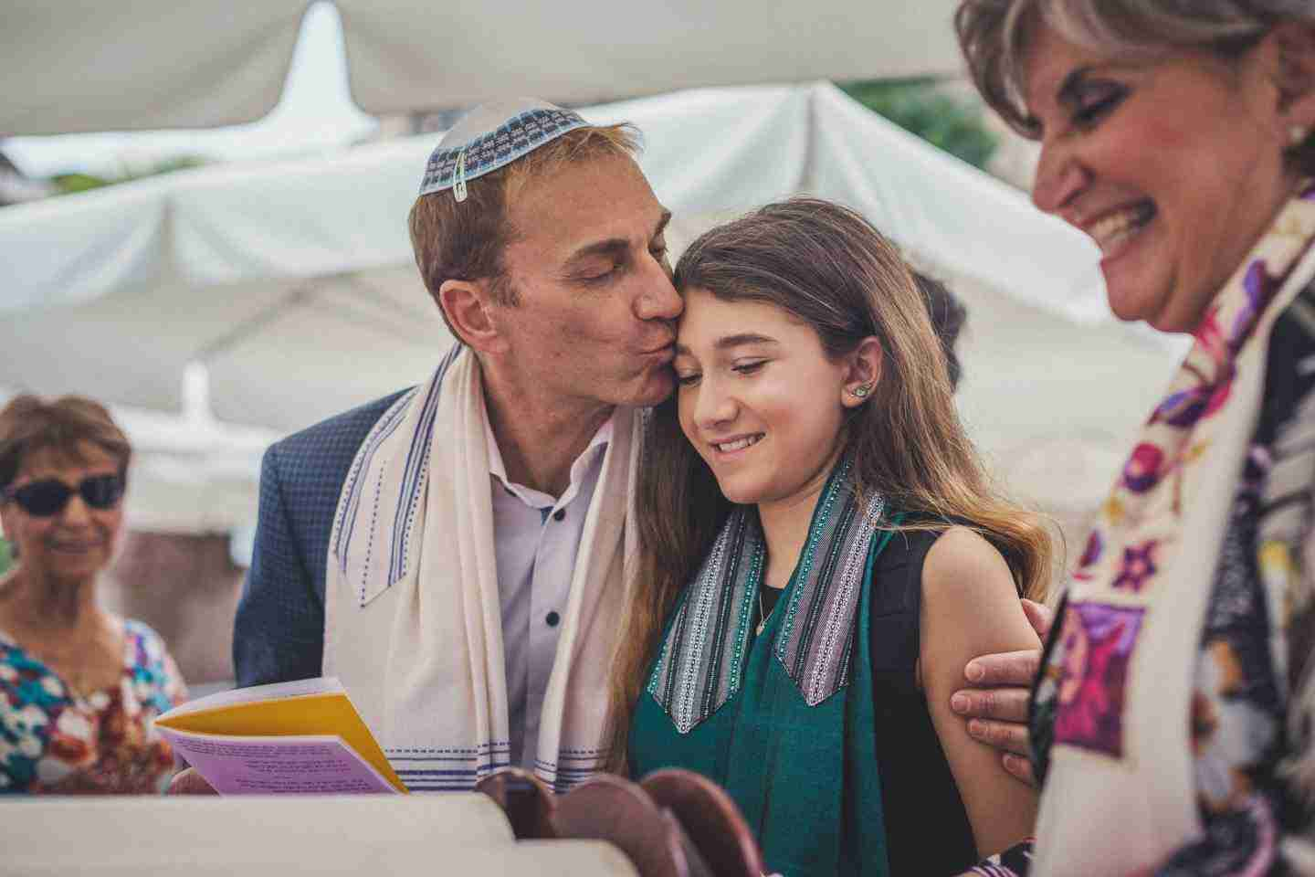 Bat Mitzvah tour in Israel: father kissing daughter at ceremony