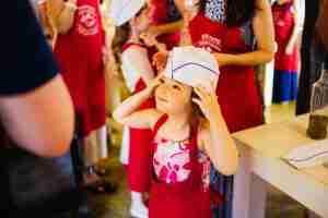 little girl at hummus workshop